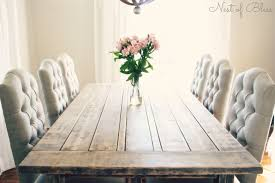 wicker emporium dining chairs paired with a rustic farmhouse table and restoration hardware knock off chandelier nest of bliss