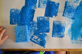 Sponge painting with a toddler