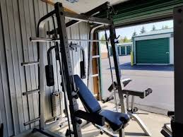 tuff stuff smith machine w bench and 255lbs olympic weights 1499 belleville michigan
