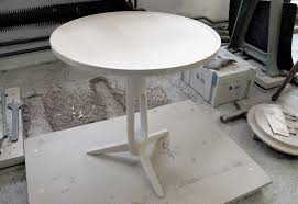 unfinished round side table with newspaper holder