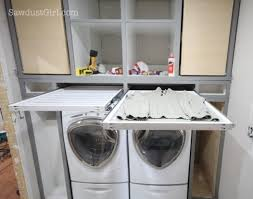 small laundry room - diy pull-out sweater drying rack, Sawdust Girl