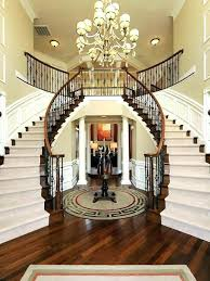 chandeliers transitional chandeliers for foyer chandelier above a dual staircase hardwood floored transitiona