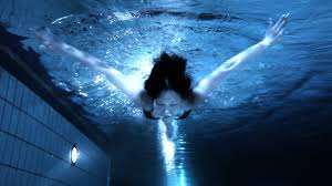 Beautiful Asian woman swimming underwater in pool at night YouTube