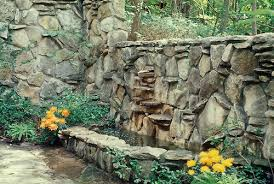 rock wall build as fountain and pool in