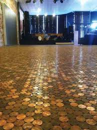 More than 300,000 pennies make up the floor of Revolver shoe store in  Noblesville, Indiana.