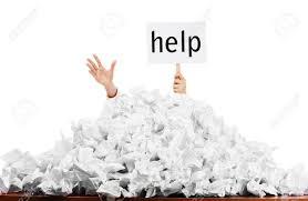 person under crumpled pile of papers hand holding a help person under crumpled pile of papers hand holding a help sign isolated against a white
