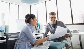 business owner sharing financial plans with a small business banking specialist