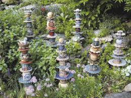 give gardens height with diy totem or tower