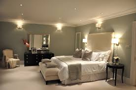 wall light fixture for luxury bedroom lighting also white cover platform bed and high tufted headboard also black vanities