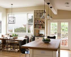 lighting above kitchen island. country eatin kitchen photo in san francisco with wood countertops lighting above island g