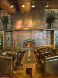 mountain style living room photo in denver with a standard fireplace and a metal fireplace