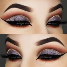 hooded eyes are characterized by featuring an extra layer of skin drooping over the crease