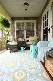 the first thing we did was add a splash of color with this beautiful indoor outdoor jade rug we both fell in love with this