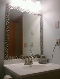 Glass tiles around mirror Jazzes up any bathroom So easy