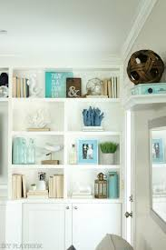 turquoise office decor. builtin shelves with simple spring touches turquoise office decor