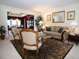 formal living room furniture. Living Room : A Formal Furniture Ideas In An Elegant White With Cozy Cream Patterned Couchs, Standing Lamps, Painting, Chairs, C