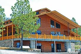 steel building homes can be constructed with wood siding