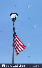 Flag Lights Pole American Flag On Light Pole Stock Photo 2482035 Alamy
