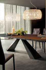 Lark Manor Stainless Steel Top Dining Table. Eliot Wood is a table with  irregular edges designed by Giorgio Cattelan. Its bold design