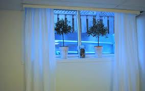 white basement window curtains