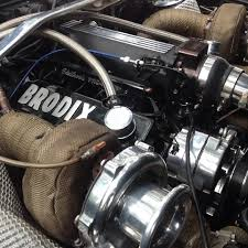 This is the twin-turbo 6.0 V8 that's lurking underneath ...
