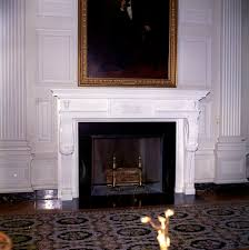 painting and fireplace in state dining room of white house