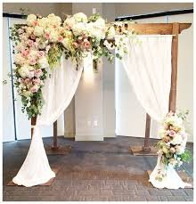 pretty wedding arch for an outdoor wedding if wanting to save money hydrangeas could be