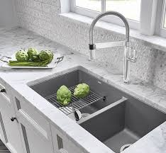 this space saving accessory is conveniently designed to provide an additional workspace in both the kitchen sink and on the kitchen counter