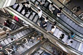 people on escalators. modern escalators can move up to 5000 people per hour. on abc