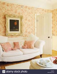 Peach Living Room Ornately Framed Picture Above White Sofa With Pink Patterned