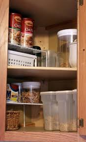 corner kitchen cabinet this cabinet has always been a little awkward it s really deep and in the corner of our kitchen things have tended to get lost