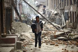 photos massive earthquake strikes newshour a man runs past damaged houses as aftershocks of an earthquake are felt a day after