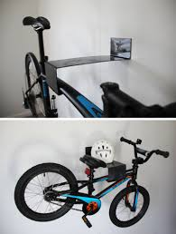Minimalist in design, this black steel bike rack stores a bike with ease.  Space at the top ensures you never forget your helmet.