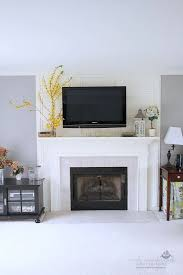 tv over fireplace and media storage great room