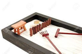 mini zen garden with white sand stones and wood rakes stock photo 5468459