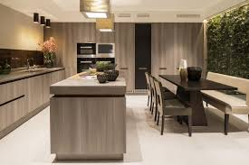 Gray wood is the main component of this luxurious kitchen, which features  floor-to