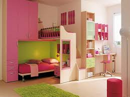 bedroom pink cream wooden bunk bed with some drawers added by pink swivel chair on