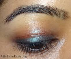 greenish blue black eye makeup 2