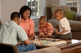 family playing board game jpg