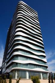 office facade. wavy balconies surround a new office building in istanbul facade