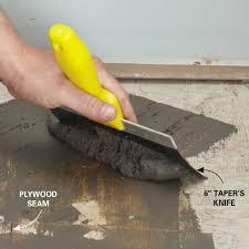 luxury vinyl tile prep the floor fill gaps and seams gaps family handyman