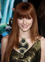 bella thorne long straight layered chic red hairstyle with bangs