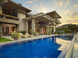 modern home architecture. Brilliant Modern Large Swimming Pool And Stone Facade On Modern Home In Modern Home Architecture S