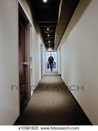 Office hallway Windows Stock Photo Young Businessman Walking Down Office Hallway Fotosearch Search Stock Photography Fotosearch Stock Photo Of Young Businessman Walking Down Office Hallway
