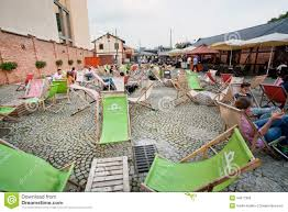 Image Decor Froy Krakow Poland Summer Chaise Lounge And Cheap Furniture In Outdoor Cafe In Urban Area Of City Krakow With Popul Of 800000 People Has 235 Mill Foreign Oizlinfo Summer Chaise Lounge And Cheap Furniture In Outdoor Cafe Editorial