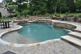 freeform pool spa with stone retaining wall