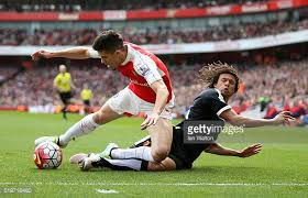 ake. gabriel of arsenal and nathan ake watford compete for the ball during barclays premier a