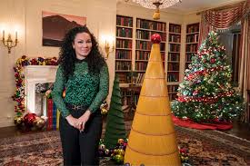 as seen on s white house christmas 2016 host egypt sherrod shows off the christmas tree made of no 1 pencils in the library of the white house