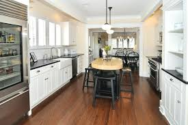 black quartz countertops black quartz kitchen traditional with a sink bin pulls image by cabinetry designs
