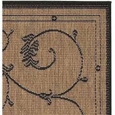 x indoor outdoor area rug with black tan fl floret vines design and oval braided rugs